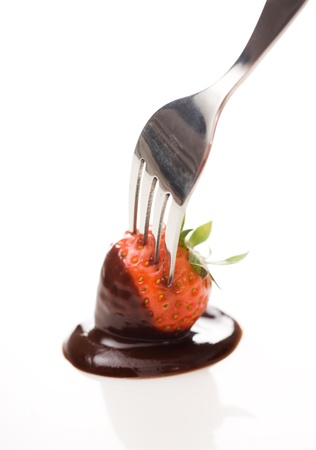 Strawberry in chocolate sauce over white background. photo