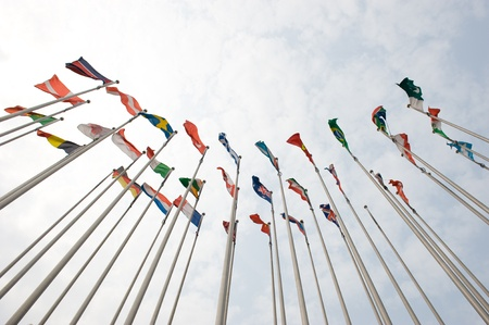 Flags of the world happily blowing in the wind.  Stock Photo - 14248279