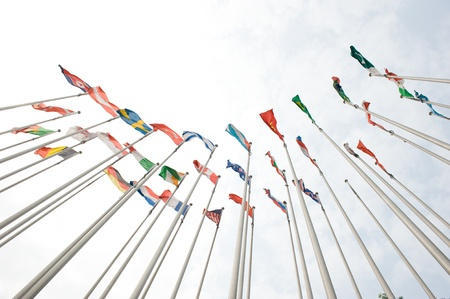 Flags of the world happily blowing in the wind.  Stock Photo