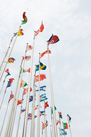 multinational: Flags of the world happily blowing in the wind.  Stock Photo