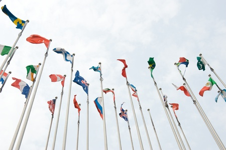 national emblem: Flags of the world happily blowing in the wind.  Stock Photo