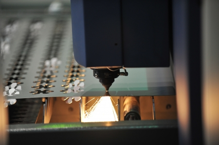 Industrial laser cutter with sparks. Stock Photo - 14248389