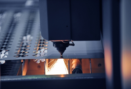 Industrial laser cutter with sparks. Stock Photo - 14248375