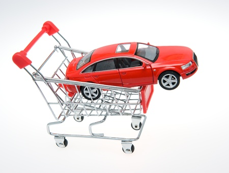 shoppingcart: Car inside a shopping cart. Stock Photo