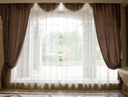 Luxury curtains with a copy-space in the middle.  Stock Photo - 14248370