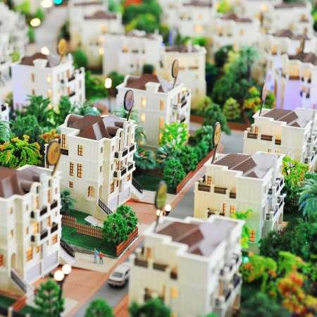 row of houses: large group of toy houses. Stock Photo
