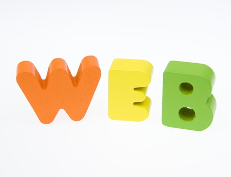 printery: Wooden letters spelling the word   web   on white background.  Stock Photo