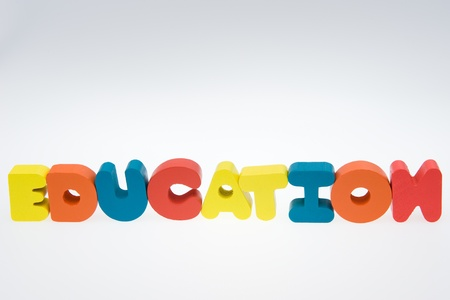 Wooden letters spelling the word   education   on white background.  photo