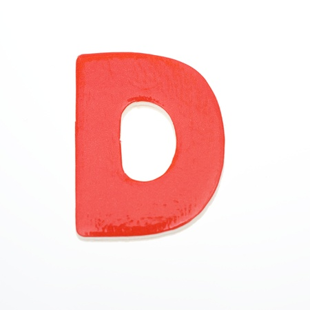 wooden toy letter D isolated on white background. photo