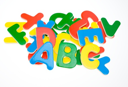 playschool: multicoloured bright wooden letters isolated on white background
