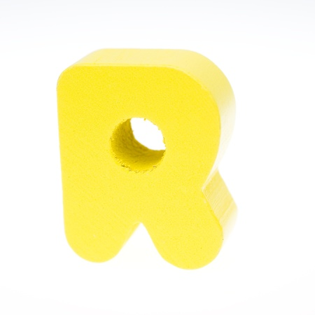 wooden toy letter R isolated on white background. photo
