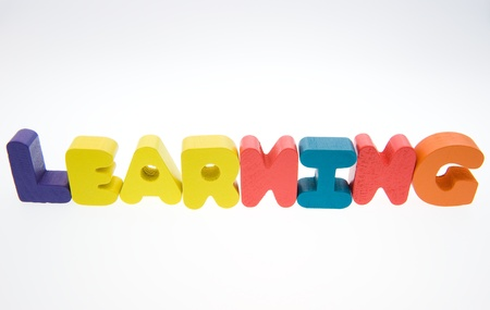 self study: Wooden letters spelling the word  learning  on white background.  Stock Photo