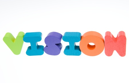 Wooden letters spelling the word  vision  on white background.  photo