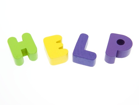 Wooden letters spelling the word  HELP  on white background.  Stock Photo - 14588435