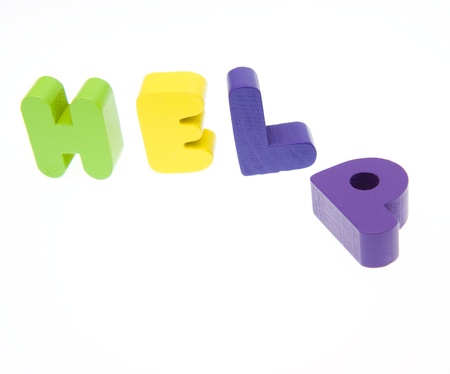 Wooden letters spelling the word  HELP  on white background. Stock Photo - 14588311