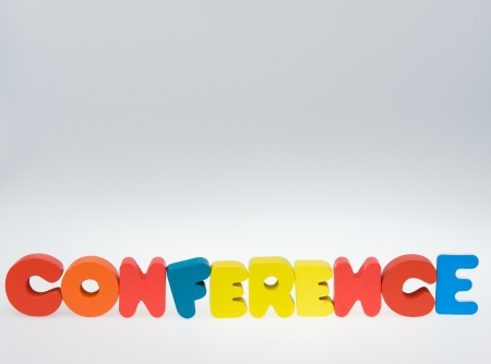 Wooden letters spelling the word   conference   on white background.  photo