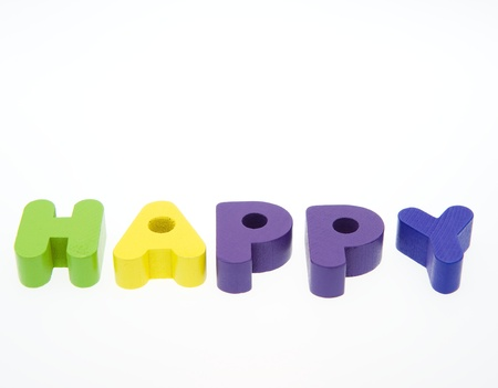 blessedness: Wooden letters spelling the word  HAPPY  on white background.
