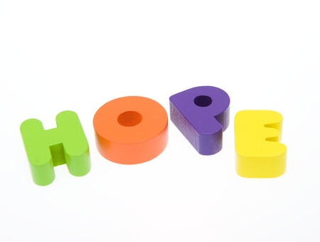 Wooden letters spelling the word  HOPE  on white background. Stock Photo - 14588477