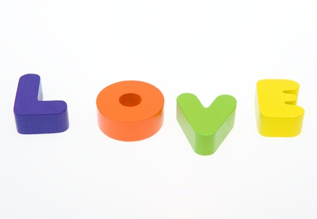 Wooden letters spelling the word   love   on white background.  Stock Photo