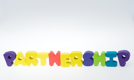 Wooden letters spelling the word   partnership   on white background.  photo