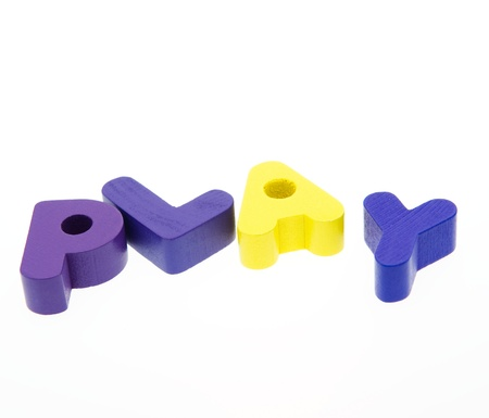 Wooden letters spelling the word  PLAY  on white background. Stock Photo - 14588342