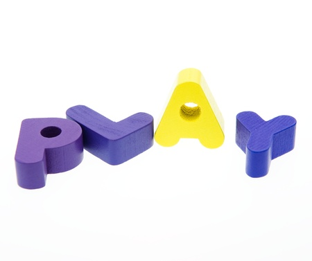 Wooden letters spelling the word  PLAY  on white background. Stock Photo - 14588485