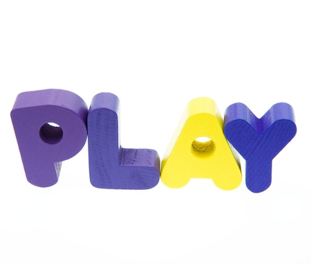 Wooden letters spelling the word  PLAY  on white background.  Stock Photo - 14588466