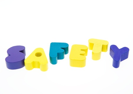 Wooden letters spelling the word  ' safety '  on white background.  photo