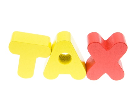 taxman: Wooden letters spelling the word   tax   on white background.