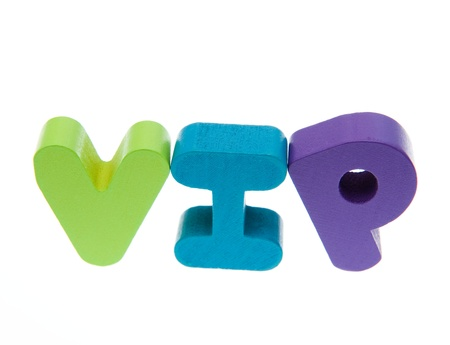 notability: Wooden letters spelling the word   vip   on white background.  Stock Photo