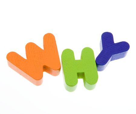Wooden letters spelling the word  ' why '  on white background.  photo