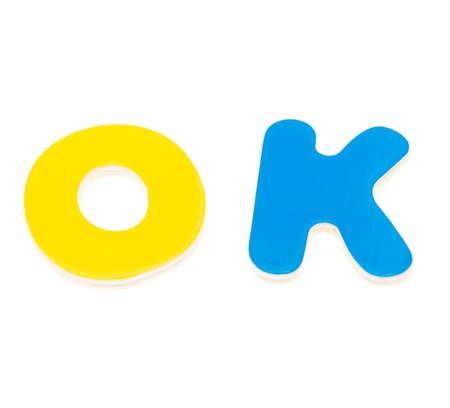 Wooden letters spelling the word OK on white background. Stock Photo - 14588230