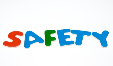 Wooden letters spelling the word  SAFETY on white background.  photo