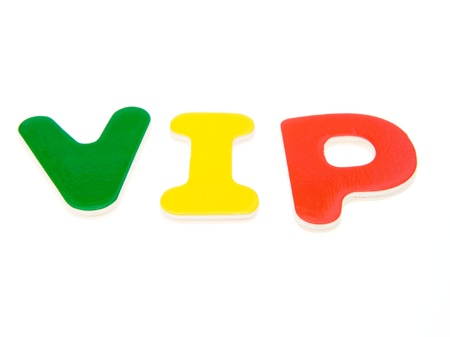 notability: Wooden letters spelling the word  VIP  on white background.