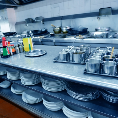 stainless steel kitchen: motion chefs of a restaurant kitchen