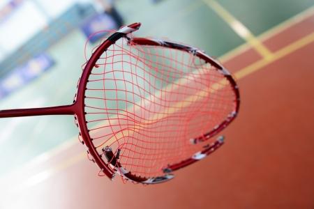 broken badminton racket in hand at badminton courts.  photo