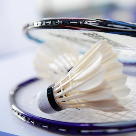 detail of shuttlecocks and badminton racket.