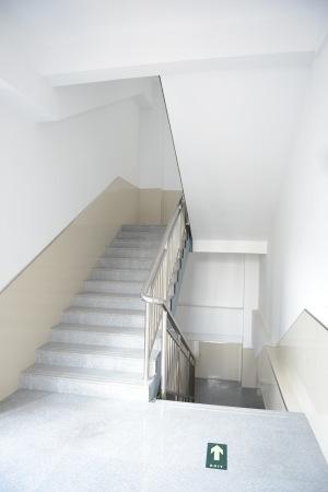 Blank stairways with steel railing.  photo