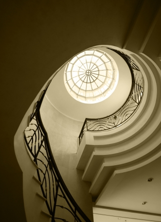 Upside view of an old spiral stairway case photo