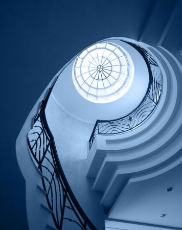 Upside view of spiral stairway case photo