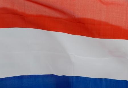 Close up shot of wavy Netherlands flag.  photo