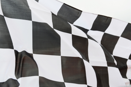 chequered: close-up of racing flag, background.