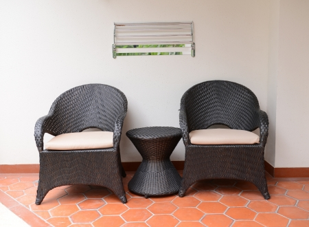 oudoors: two chairs with table in the balcony
