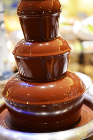 dipped: Chocolate fondue fountain  dipped in a restaurant.