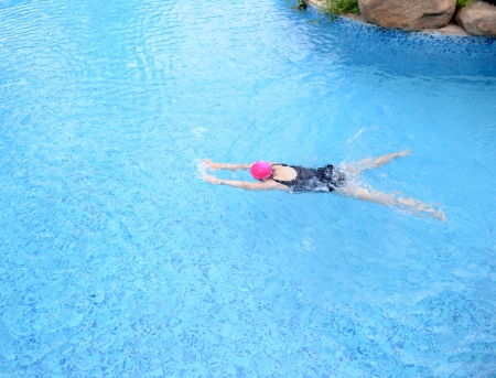 pool diving: Top view of young woman diving in a swimming pool
