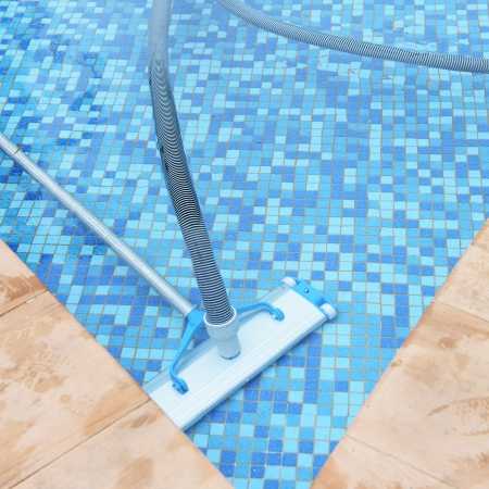 swimming pool home: Swimming pool cleaning tools in the bottom. Stock Photo