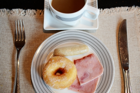 greasy: Breakfast with bread, meat, sausage and coffee. Stock Photo