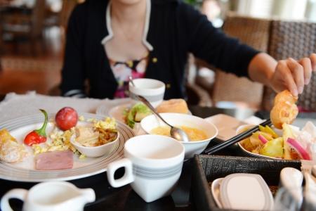 breakfast hotel: Female having a healthy breakfast in hotel. Stock Photo