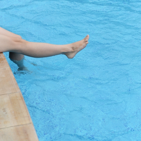 female feet in the pool making splashes. Stock Photo - 15137029