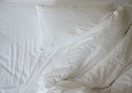 comforter: close up of messy bedding sheets and pillow